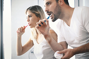 couple brushing teeth with activated charcoal
